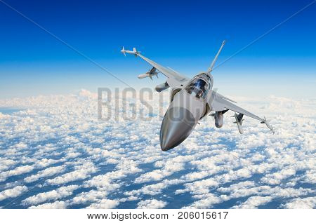 Military Fighter Jet Above The Clouds.