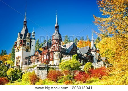 Peles Castle Romania. Famous Neo-Renaissance castle and ornamental garden in Sinaia Carpathian Mountains in Europe.