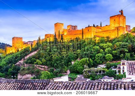 Granada Spain. Twilight with famous Alhambra Alcazaba. Andalusia medieval province.