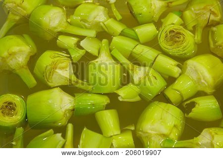 Artichoke hearts soaking in water to get clean