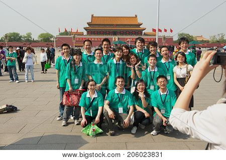 BEIJING, CHINA - MAY 01, 2009: Unidentified students make group photo at Tiananmen square on Students day in Beijing, China.