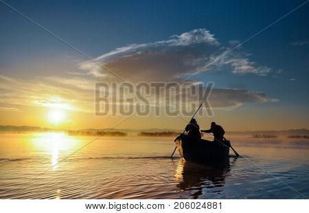 working for fishermen & fisherman concept in lake