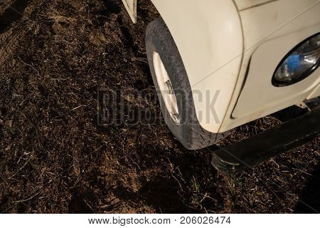 High angle view of off road vehicle parked on field