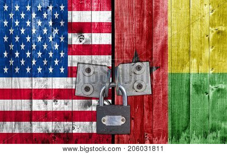 US and Guinea Bissau flag on door with padlock