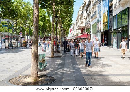 PARIS,FRANCE - JULY 29,2017 : The Champs-Elysees next to the Lido Cabaret in central Paris on a sunny summer day