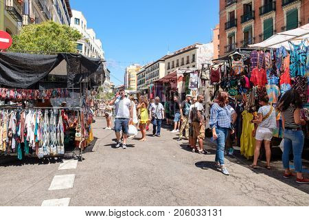 MADRID,SPAIN - AUGUST 6,2017 : People shopping at El Rastro, the most popular open air market in Madrid
