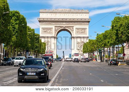 PARIS,FRANCE - JULY 29,2017 : The Champs-Elysees next to the Arc de Triomphe in central Paris on a sunny summer day