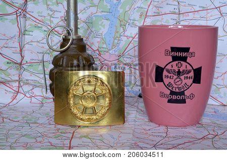ILLUSTRATIVE EDITORIAL.Buckle of Ukrainian Nazional Guard..Souvenir mug with German nazi symbols.Incription -  VINNITSA-WERVOLF (UKR). Kiev,Ukraine.September 11, 2017