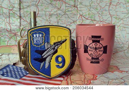 ILLUSTRATIVE EDITORIAL.Chevron of Ukrainian army.Souvenir mug with German nazi symbols.Incription -  VIINITSA-WERVOLF (UKR). Kiev,Ukraine.September 11, 2017