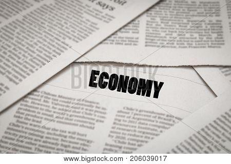 economy topic or headline on newspaper background