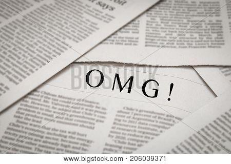 OMG! topic or headline on newspaper background