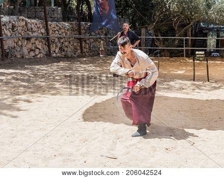 Jerusalem Israel September 23 2017 : The Ukrainian Cossack demonstrates possession of two sickles at the festival