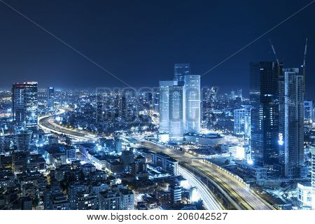 Tel Aviv Skyline At Night, Skyscraper and Ayalon Freeway - Toned In Blue