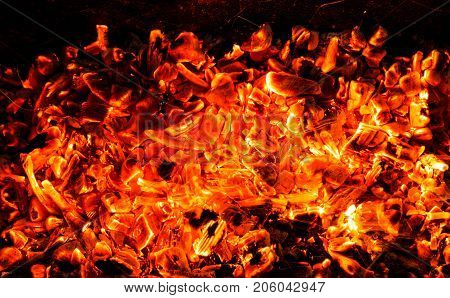 background of burning coals . Photo of an abstract texture