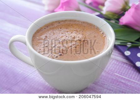 Cup of aromatic morning coffee on table