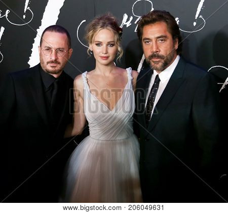 NEW YORK-SEP 13: (L-R) Director Darren Aronofsky and actors Jennifer Lawrence and Javier Bardem attend the