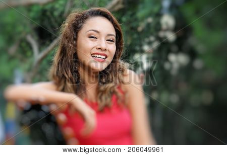 Hispanic Attractive Female Sitting on a Park Bench