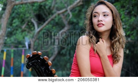 Fearful Young Female Sitting on a Park Bench