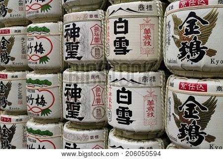 Kyoto, Japan - May 17,2017: Piled traditional Sake Barrel Offerings displayed at the temple