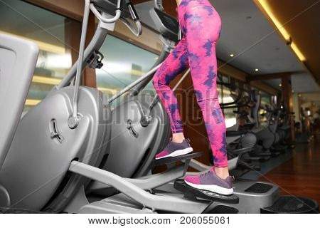 Beautiful young woman training in gym