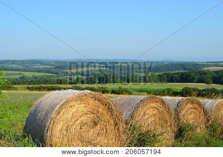 Hay bales in the field on the farms and hills of upstate New York in summer