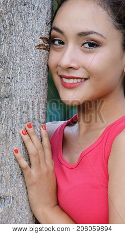 Latina Female Smiling Wearing a Pink Shirt