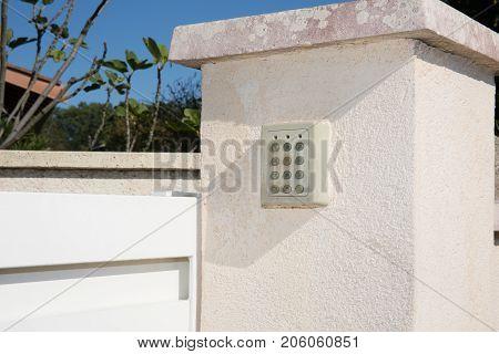 Electronic Lock Door Intercom On The Wall Background