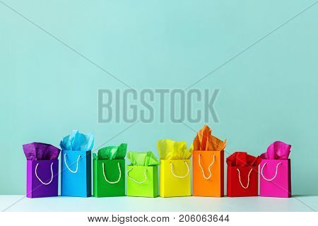 Row of colorful shopping bags with copy space above