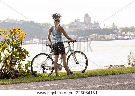Young Woman Riding Bike outside having fun