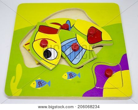 Wooden colorful puzzle with fish for toddler