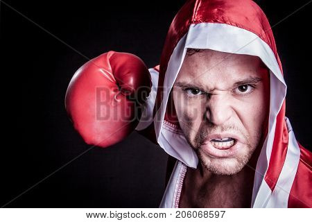 Professional aggressive boxer man punching