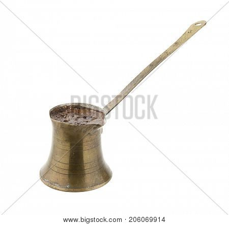Traditional Turkish coffeepot made of brass full of Turkish coffee isolated on white background.