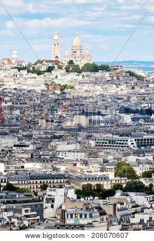 Aerial view of Paris with the Sacre Coeur Basilica and Montmartre on the top