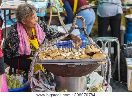 Bankok Thailand - Sep 9 2017 Unidetified Street vendor roasted casava and banana in Yaowarat or Chinatown