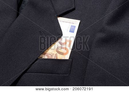 Fifty euros banknote in business man black suit pocket