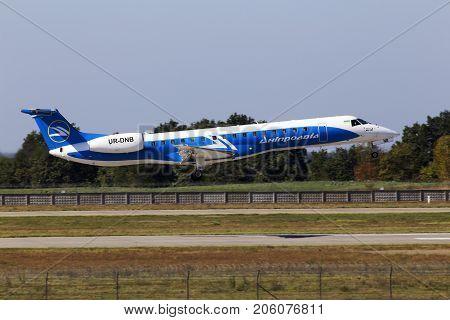 Borispol, Ukraine - September 26, 2017: Dniproavia Embraer ERJ-145 aircraft landing on the runway to Borispol International Airport on September 26, 2017. Editorial use only