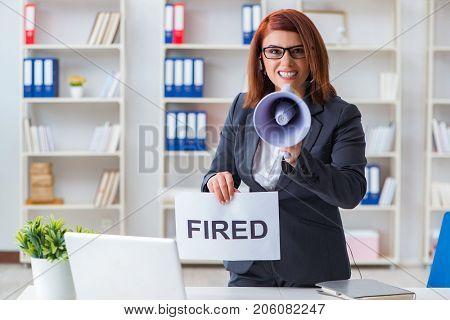 Businesswoman firing people in office