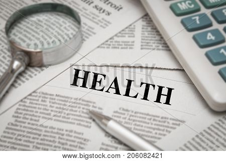 health headline on newspaper background with magnifying glass