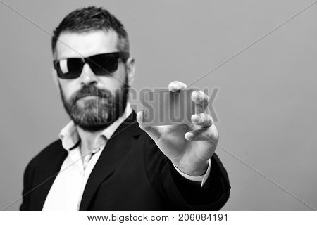 Businessman With Empty Card And Copy Space. Man With Beard