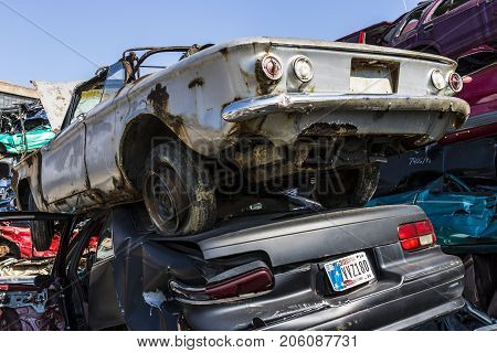 Indianapolis - Circa September 2017: Stacked junk yard Corvair and Impala prepared for crushing to be recycled I