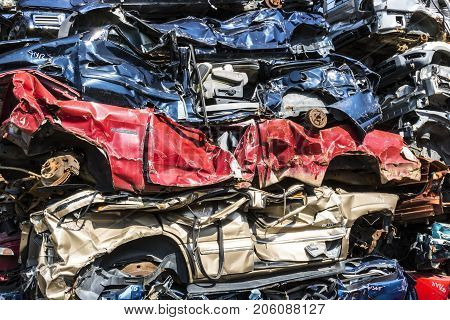 Indianapolis - Circa September 2017: Stacked junk yard clunker cars prepared for crushing to be recycled IX