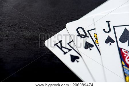 Closeup of full house spade cards with king queen jack
