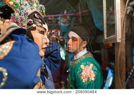 In The Backstage Of A Chinese Opera, Actors Finish Dressing And Makeup