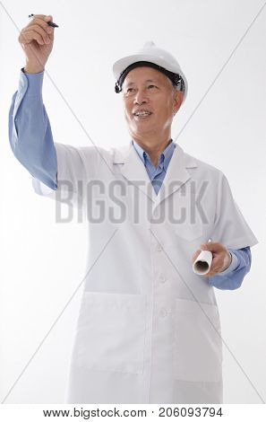 Portrait of Asian engineer with hard hat and blueprint, hand writing on blank space, standing isolated on white background.