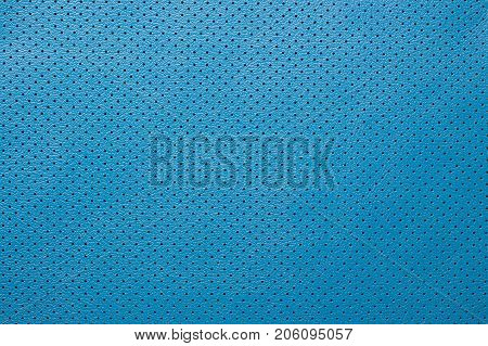 Blue perforated leather texture background skin fabric