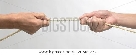 white hands in tug of war