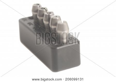 Tool holder collets of different size in a box isolated on white background