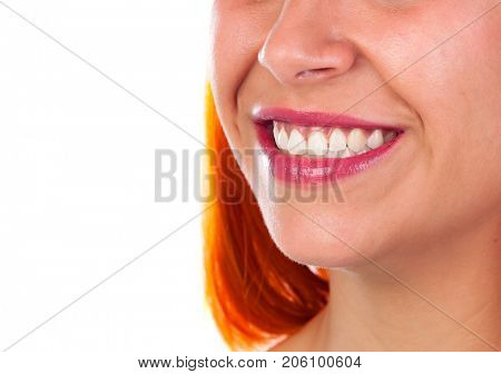 Beautiful smile of a redhead woman, she is caring her teeth