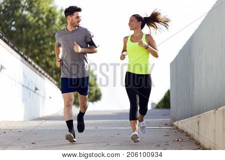 Beautiful Couple Running In The Street.