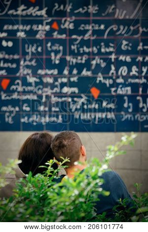 PARIS, FRANCE - MAY 13: Le Mur des Je t'aime (the Wall of Love) with a couple on May 13, 2015 in Paris. It is the most-visited paid monument in the world with annual 250M visitors.